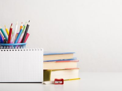 New academic year concept. School and office supplies with books on white background, panorama, copy space